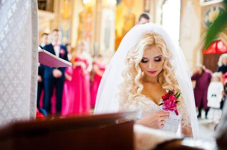 debutante: Style blonde bride kneeling at church