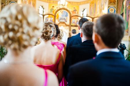 debutante: Stylish groomsmen and bridesmaids at the church Stock Photo