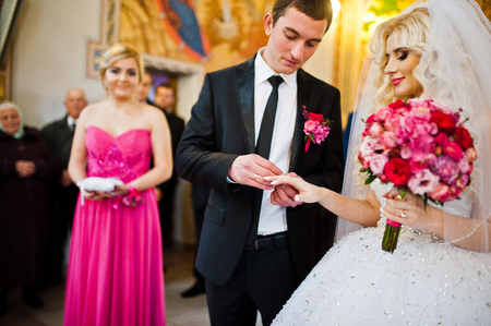 debutante: Groom wears a wedding ring on the hand of the bride