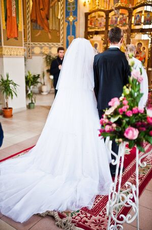 debutante: Back of elegant wedding couple at the church