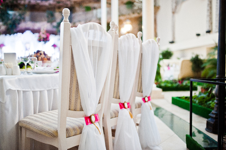 wedding chairs: Wedding chairs with pink bow and brooch