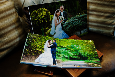 big picture: Brown leather wedding book and album with big picture on canvas