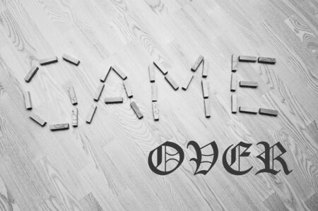 over: Wooden blocks with Game Over phrase on wooden background