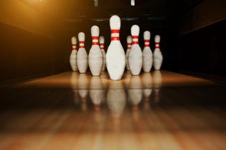 bowling alley: Ten white pins in a bowling alley lane