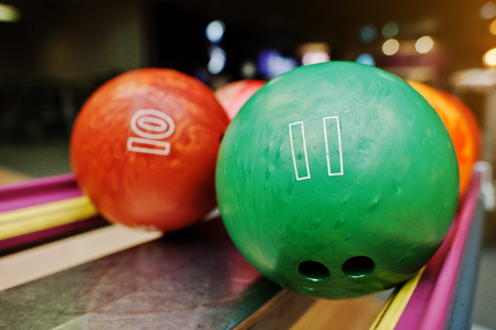 number 11: Two colored bowling balls of number 11 and 10