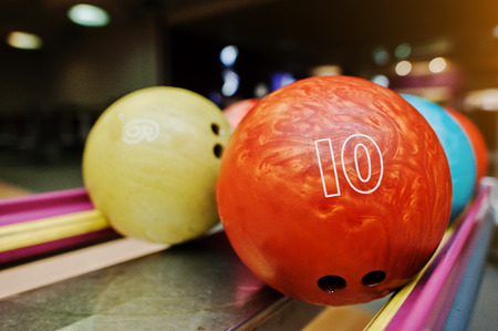 number 10: Two colored bowling balls of number 10 and 9