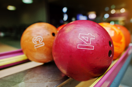 number 14: Two colored bowling balls of number 14 and 13