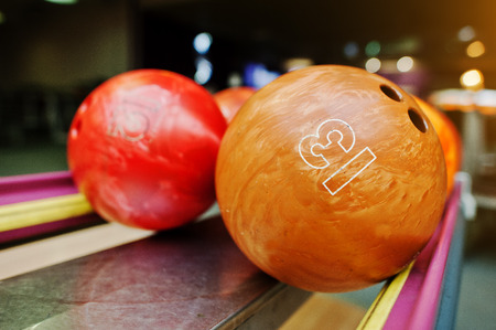 12 13: Two colored bowling balls of number 13 and 12