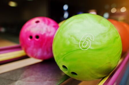 alleys: Two colored bowling balls of number 6 and 7. Kids ball for bowling