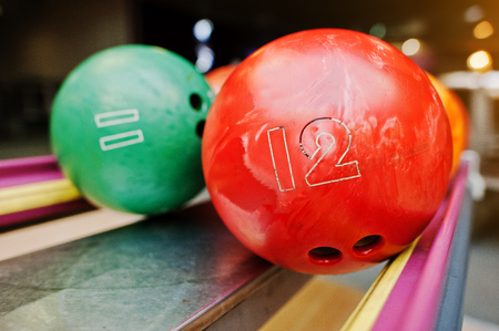 number 11: Two colored bowling balls of number 12 and 11
