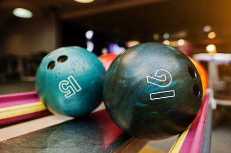 number 16: Two colored bowling balls of number 16 and 15