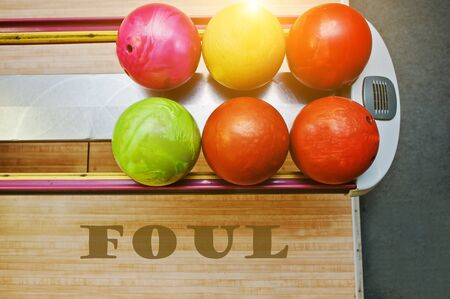 foul: The word foul background bowling balls Stock Photo