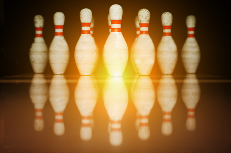 bowling strike: Ten white pins in a bowling alley lane