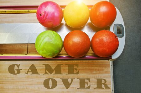 word game: The word game over background bowling balls Stock Photo