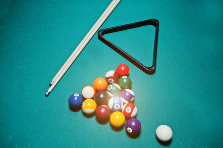 pool halls: Billiard balls in a pool table at triangle with billiard cue