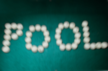 snooker halls: The word pool from billiard balls, blured effect