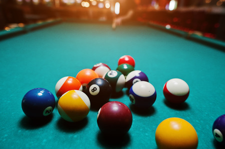snooker hall: Billiard balls in a pool table after shoot