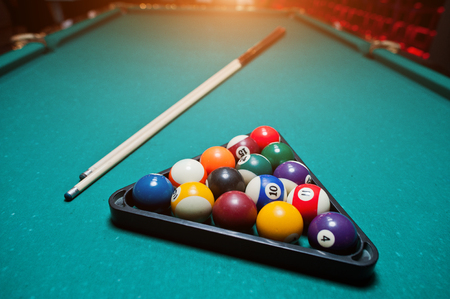 9 ball billiards: Billiard balls in a pool table at triangle with billiard cue