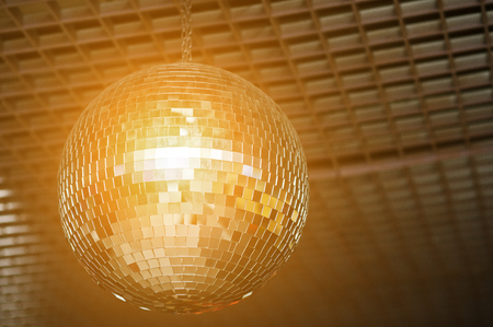 mirrorball: Shined disco mirror ball over the dance floor Stock Photo