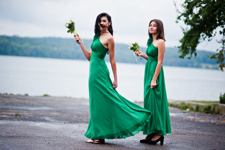 charmed: Two charmed girls bridesmaids on green dress
