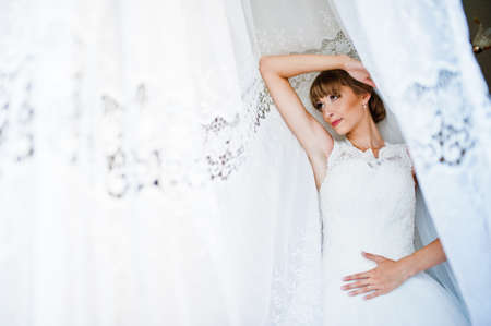 posed: Young bride posed in curtains