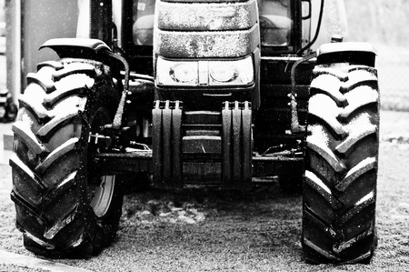 traction engine: Wheels of new tractor in snowy weather Stock Photo