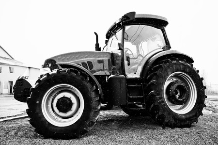 traction engine: Black and white photo of tractor in snowy weather Stock Photo