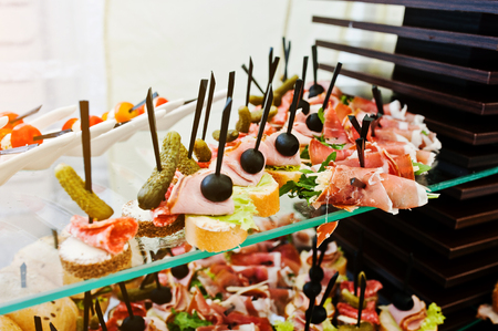 cater: Buffet table of reception with burgers, cold snacks, meat and salads