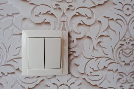 light switch: Electric light switch at vintage decor wall Stock Photo
