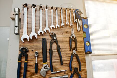 toolkit: Group of used tools on wood deck, toolkit Stock Photo