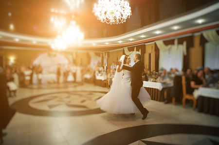 Amazing first wedding dance of stylish wedding couple at luxury restaurant