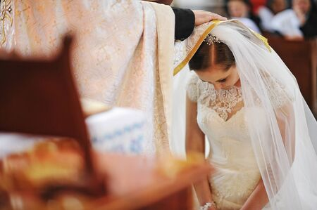 blessings: Priest puts hand the blessings of bride Stock Photo