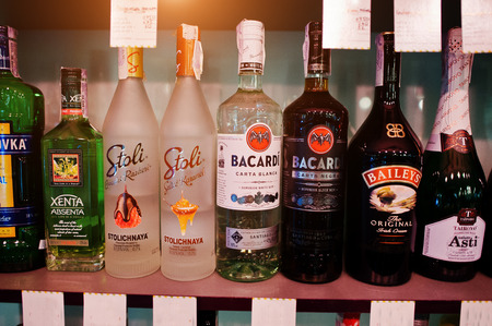 KYIV, UKRAINE - MARCH 25, 2016: Various alcoholic beverages bottles in the bar. Editorial
