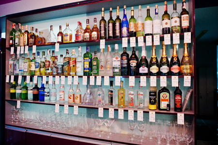 baileys: KYIV, UKRAINE - MARCH 25, 2016: Various alcoholic beverages bottles in the bar on the shelf. Editorial