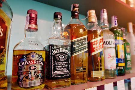 daniels: KYIV, UKRAINE - MARCH 25, 2016: Various alcoholic beverages bottles in the bar. Chivas Regal, Jack Daniels and Black Label at center
