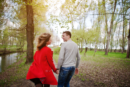 park path: Couple in love running on a park path