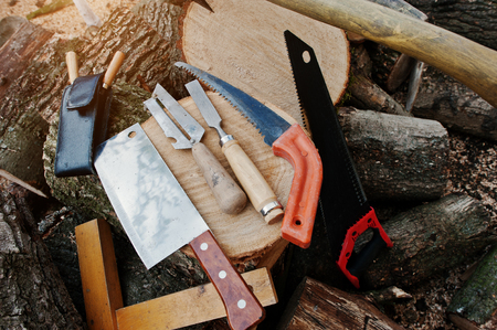 bark carving: Wood working tools background chopped firewood.