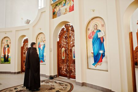 liturgy: LVIV, UKRAINE - APRIL 27, 2016: Holy Week passion and death of Jesus Christ. Priest monk franciscan is holy liturgy in the church