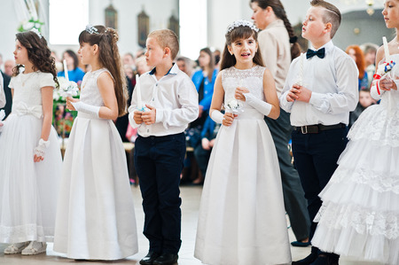 christian youth: LVIV, UKRAINE - MAY 8, 2016: The ceremony of a First Communion in the Church of St. Peter the Great of Ukrainian Greek Catholic Church.