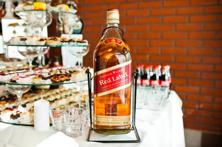 litre: Khutir, Ukraine - May 8, 2016: Bottle of 4.5 litre elite alcohol blended scotch whisky Johnie Walker Red Label on wedding reception.