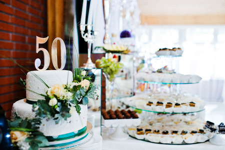 Cake anniversary in 50 at table Stock Photo