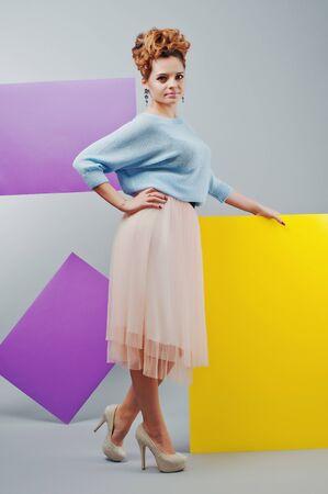 blanks: Full length studio portrait of young girl near art colored blanks. Stock Photo