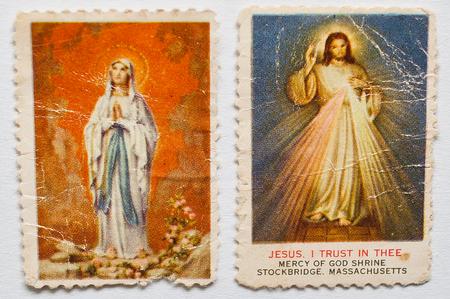 showed: UZHGOROD, UKRAINE - CIRCA MAY, 2016: Postage stamps showed Jesus Christ and Holy Mary with slogan  Jesus, i trust in thee. Mercy of God shrine, Stockbridge, Massachusetts  Editorial
