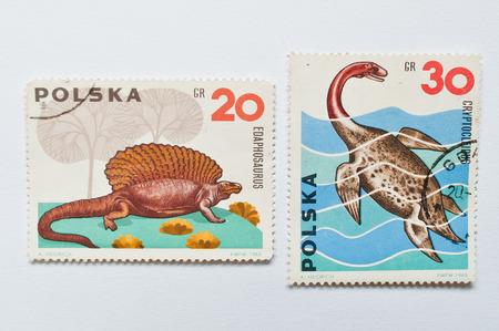 postage stamps: UZHGOROD, UKRAINE - CIRCA MAY, 2016: Collection of postage stamps printed in Poland shows dinosaur, circa 1965