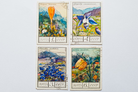 philatelist: UZHGOROD, UKRAINE - CIRCA MAY, 2016: Collection of postage stamps printed in USSR, shows mountain plants and flowers series, circa 1976 Editorial