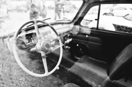 gearstick: Interior and steering wheel on old vintage retro car. Black and white photo