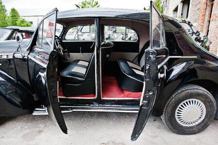 automobile door: Car door open from the inside at vintage classic automobile.