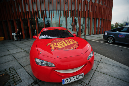 disney cartoon: Katowice, Poland - October 24, 2014: Lightning McQueen a larger version of the car, cartoon character of the Disney Pixar feature film Cars.