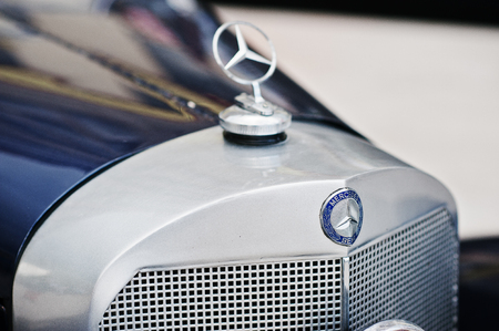 mania: Podol, Ukraine - May 19, 2016: Logo of German firm Mercedes-Benz at luxury retro classic car Mercedes-Benz 540K