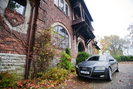 automaker: Sosnowiec, Poland - October 23, 2014: Audi S6 (Audi A6),  car produced by German automaker Audi background old mansion Editorial